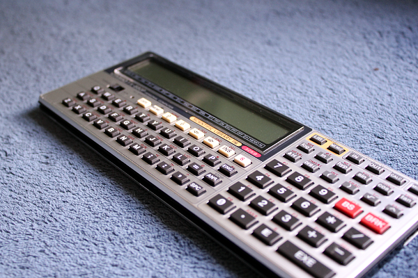 Casio fx-9860g slim graphing calculator usb power compact size.