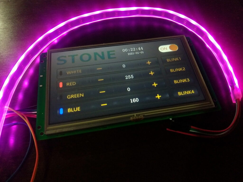LCD Display connected to a RGB strip, showing a User Interface with buttons to change the colors.