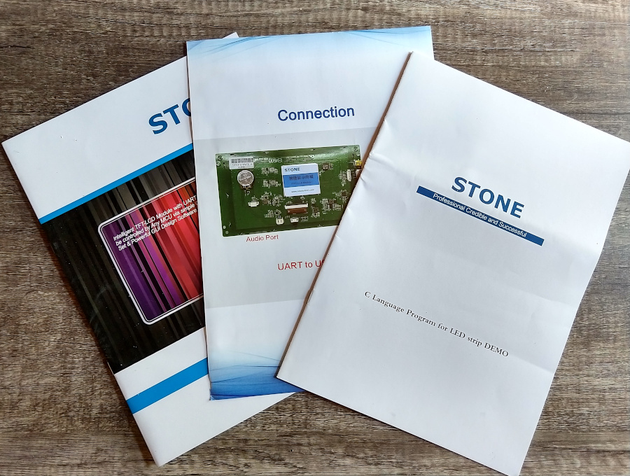 Three printed brochures and pamphlets in blue text over white branding.